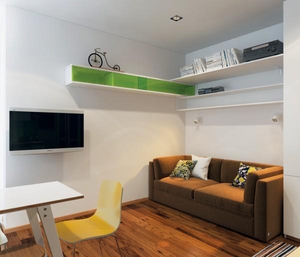 Phòng khách thiết kế tối giản với chiếc sofa màu nâu ấm áp.